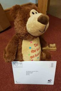 Tag the bear, from Supported Holidays, takes a trip to the post office